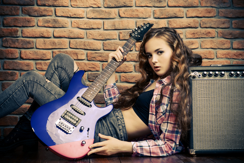 A girl with an electric guitar